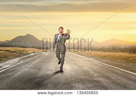 Emotional running businessman .  Mixed media