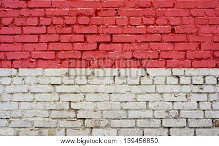 Flag of Monaco painted on brick wall background texture
