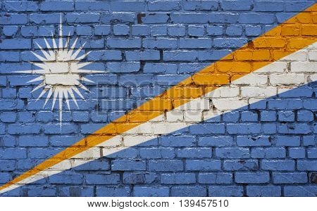 Flag of Marshall Islands painted on brick wall background texture