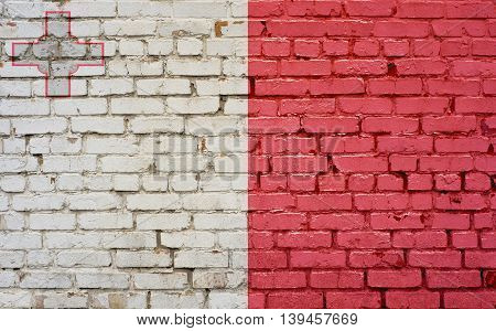 Flag of Malta painted on brick wall background texture