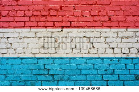 Flag of Luxembourg painted on brick wall background texture