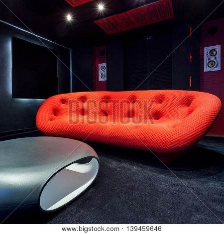 Red Couch And Modern Table