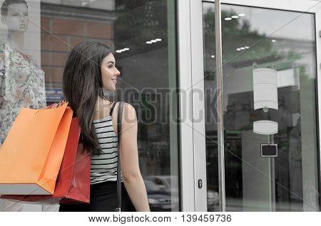 Rear View Of A Girl Walks Into The Shop Door