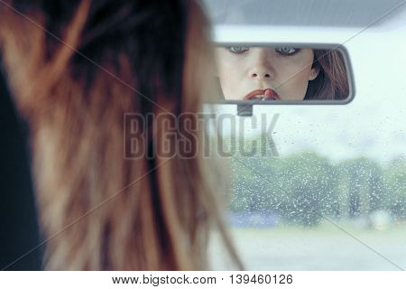 Reflection In The Rearview Mirror Of A Girl