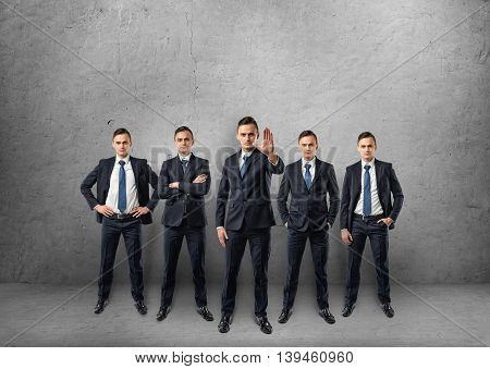 Five full-lenght businessmen standing in different poses isolated on the white background. Succesful teamwork. Business staff. Office clothes.
