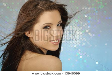 Glamour portrait of sexy girl on blue background