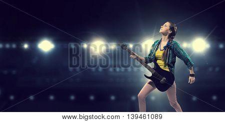 Female rock guitarist .  Mixed media