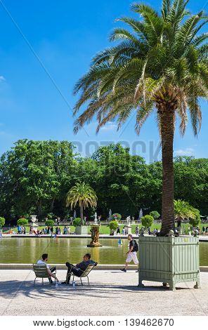 Paris France - Jule 07 2016: People enjoy sunny day in the Luxembourg Garden in Paris.