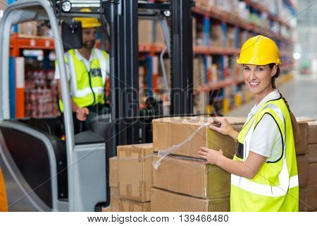 Portrait of workers are posing and looking the camera during work in a warehouse