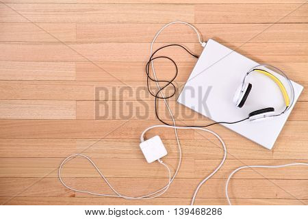 Headphones and a Laptop on the Floor.
