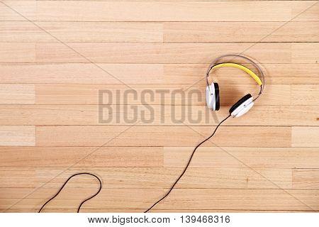 Headphones on a wooden floor. A digital photo.