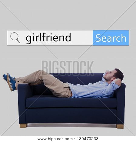 Internet And Online Dating Concept - Search Bar And Man Lying On Sofa And Dreaming About Girlfriend