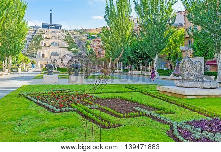 YEREVAN ARMENIA - MAY 29 2016: The Tamanyan street located next to the Cascade is the part of the Monument neighborhood famous modern art site on May 29 in Yerevan.