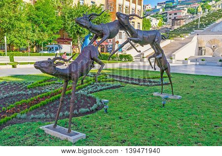 YEREVAN ARMENIA - MAY 29 2016: The sculpture depicting group of running antelopes located in Cafesjian Art Center garden on May 29 in Yerevan.