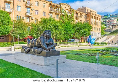 YEREVAN ARMENIA - MAY 29 2016: The Cafesjian sculpture garden boasts Botero sculptures the Smoking Woman is the pearl of its collection on May 29 in Yerevan.