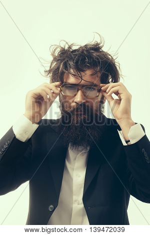 young handsome bearded man crazy genius scientist or professor in glasses with long beard and hair isolated on white background