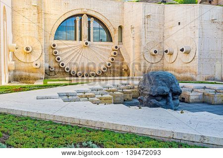 YEREVAN ARMENIA - MAY 29 2016: The fountains and pool with the sculpture of man's head in the second level of Cascade on May 29 in Yerevan.
