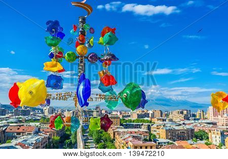 YEREVAN ARMENIA - MAY 29 2016: The skyline of the city and Ararat Mount through the weathervane glass tree on the upper level of Cascade on May 29 in Yerevan.