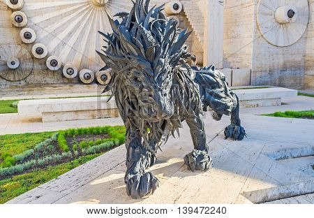 YEREVAN ARMENIA - MAY 29 2016: The unusual black lion made of tires is the sculpture of Ji Yong-Ho located in Cascade on May 29 in Yerevan.