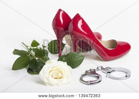 red high heels with a rose on white background