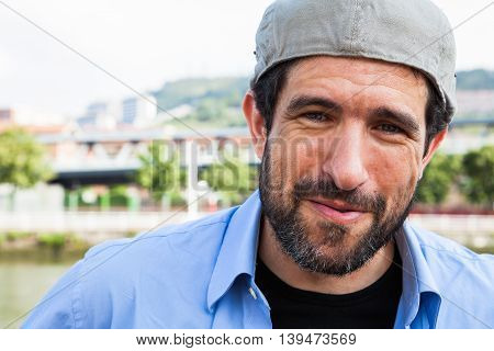 Close-up of a bearded man and Irish cap on backwards