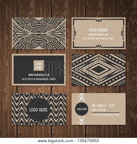 Eco style business card collection set . Ethnic tribal style business card collection on wood background.