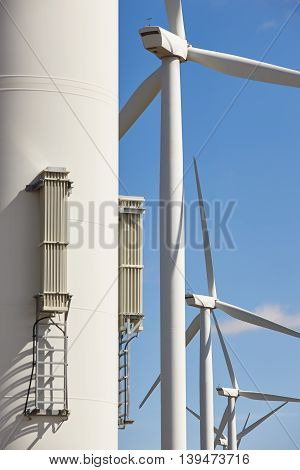Wind turbines in line. Clean alternative renewable energy. Vertical