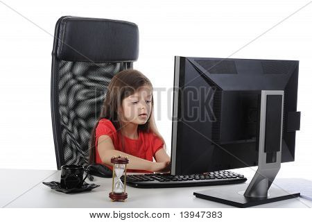Little girl in the office computer.