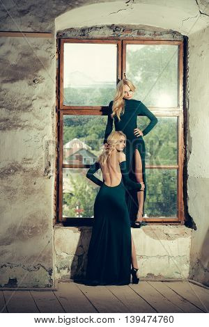 Pretty Women In Green Dresses Near Window