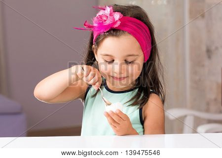Little Girl Is Eating Egg With Pleasure