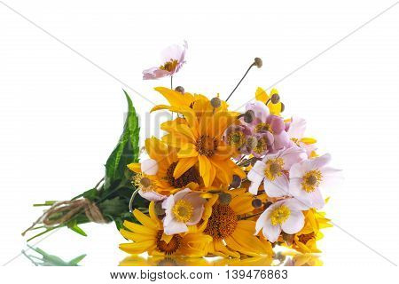 Summer bouquet of yellow daisies on a white background
