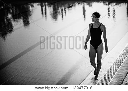 Attractive Female Swimmer Walking By The Pool