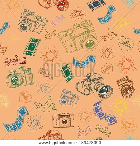 Photo camera and film sign symbol doodles hand drawn seamless pattern