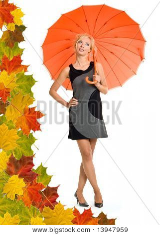 Woman with orange umbrella. Leaves background