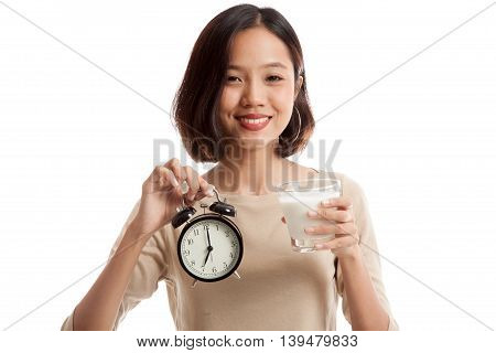 Healthy Asian Woman Drinking  Glass Of Milk Hold Clock