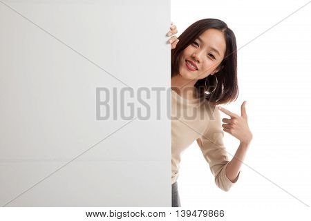 Young Asian Woman Point To A  Blank Sign