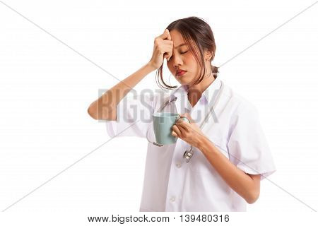 Asian Young Female Doctor Got Headache With A Cup Of Coffee