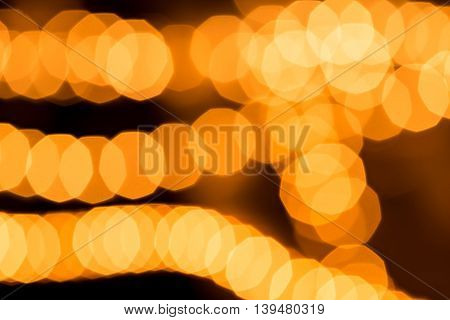 Abstract golden background circular bokeh out of focus lights