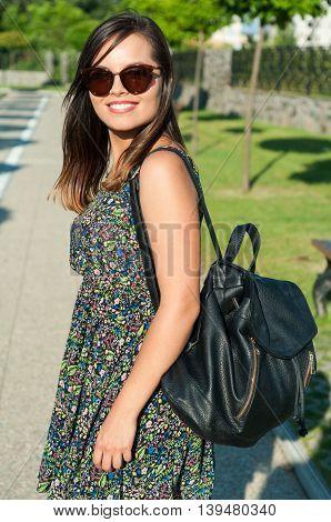 Beautiful Young Lady Posing In Park Wearing Dress