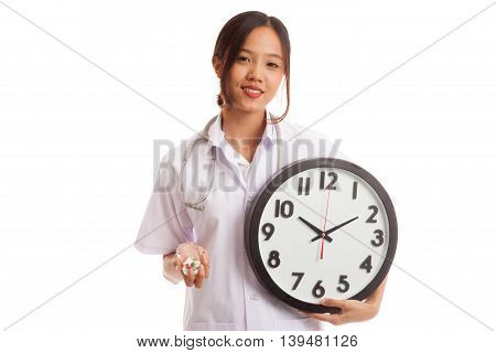 Young Asian Female Doctor Smile With A Clock And Pills