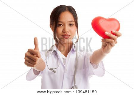 Young Asian Nurse Thumbs Up With Red Heart