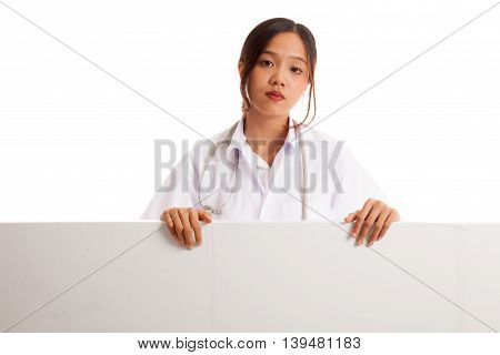 Young Asian Female Doctor Show Thumbs Up  Behind Blank White Billboard