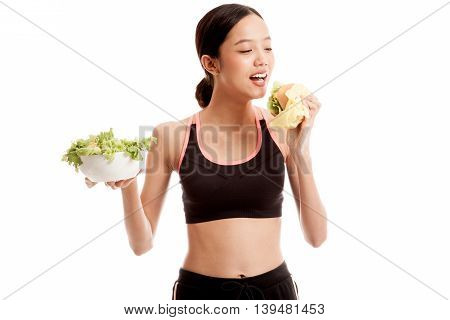 Beautiful Asian Healthy Girl With Salad And Hamburger