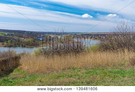 Landscape with riverside of small Ukrainian river Sura at early spring season