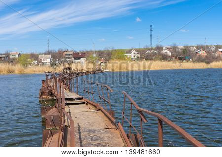 Pontoon bridge over small river to remote Ukrainian village