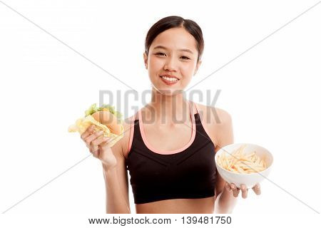 Beautiful Asian Healthy Girl With French Fries And Hamburger