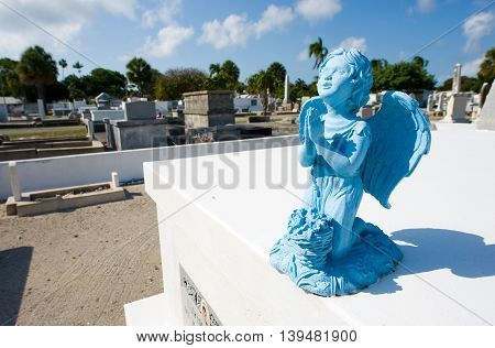 KEY WEST FLORIDA USA - MAY 02 2016: Blue angel on the grave at Key West cemetery. It is a 19-acres cemetery and about 100.000 people are buried here.