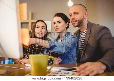 Team of graphic designer working on computer in the office