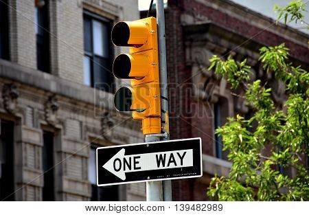 New York City - June 2 2016: Traffic light and one way street sign at West 143rd Street and Broadway in Hamilton Heights