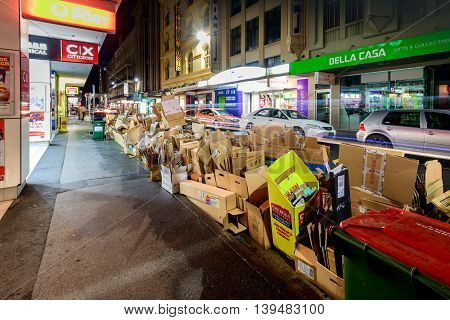 Adelaide South Australia - August 11 2015: Recyclable waste collection day in Adelaide city. Night view of the street with paper boxes